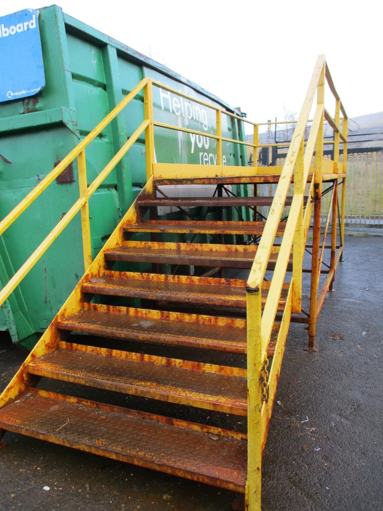 A man was injured when he manually moved steps weighting in excess of 950kg at a recycling plant.