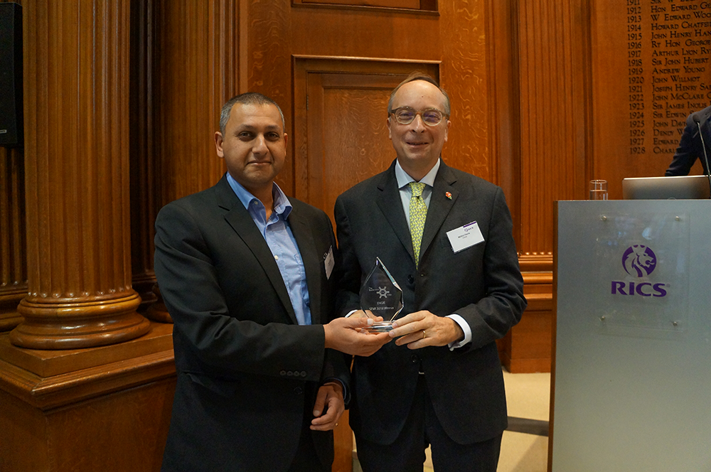 Sunil Shah Acclaro/SFMI MD (left) presenting the award to Wilfrid Petrie, CEO, Engie UK & Ireland.