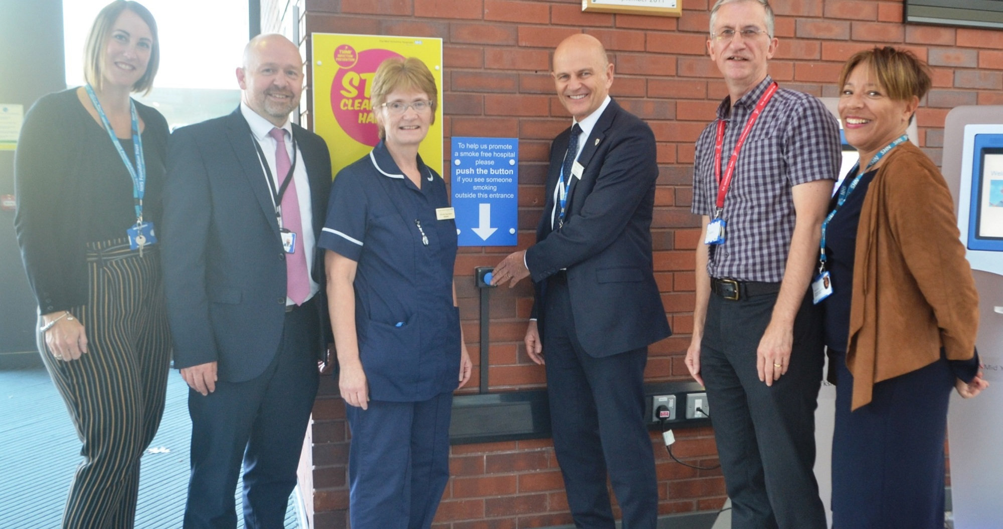 Out for a crafty fag - no Iain Brodie, General Manager of Facilities and colleagues stand by the blue button at Pinderfields Hospital which when pressed will cause smokers to be shouted at to put their cigarettes out