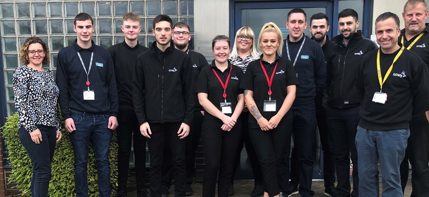 Seven of the eight new apprentices Amey apprentices and teaching staff.
