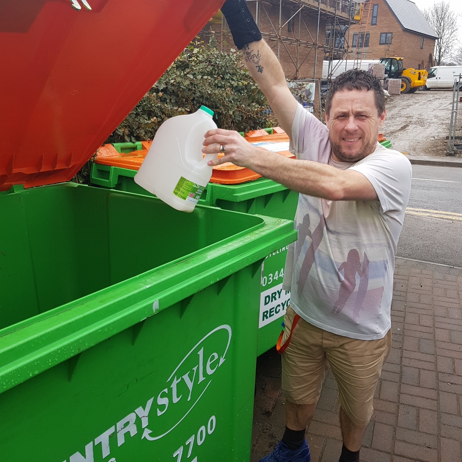 Support worker Mark Williams recycling at Winchester House.